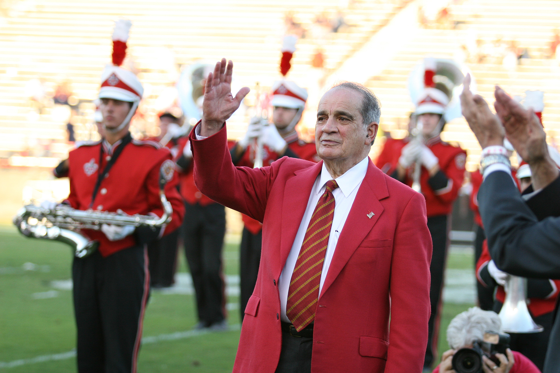 Dr. Ray Authement waves to the crowd at Cajun Field with the Pride of Acadiana